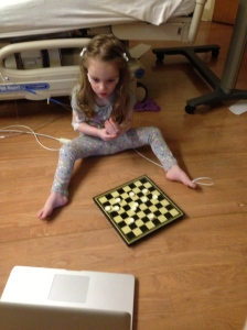 Nora playing checkers